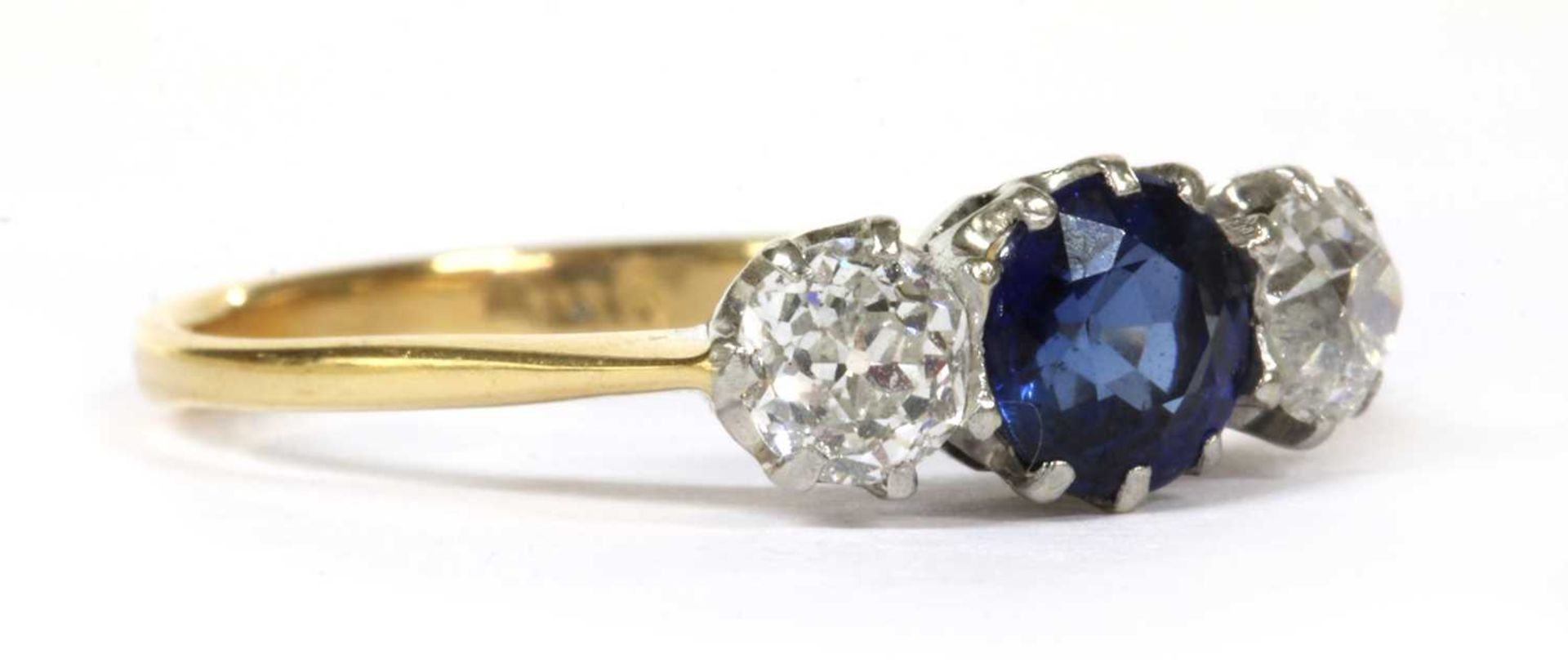 A gold three stone sapphire and diamond ring, - Image 3 of 4