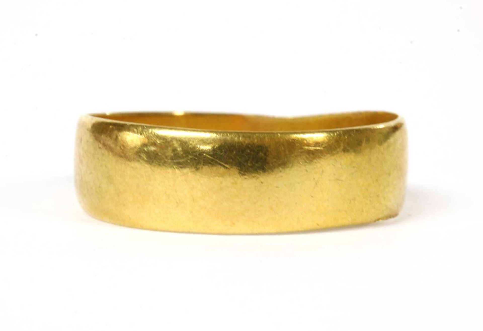 A 22ct gold flat section wedding ring,