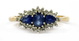A 9ct gold sapphire and diamond three stone cluster ring,