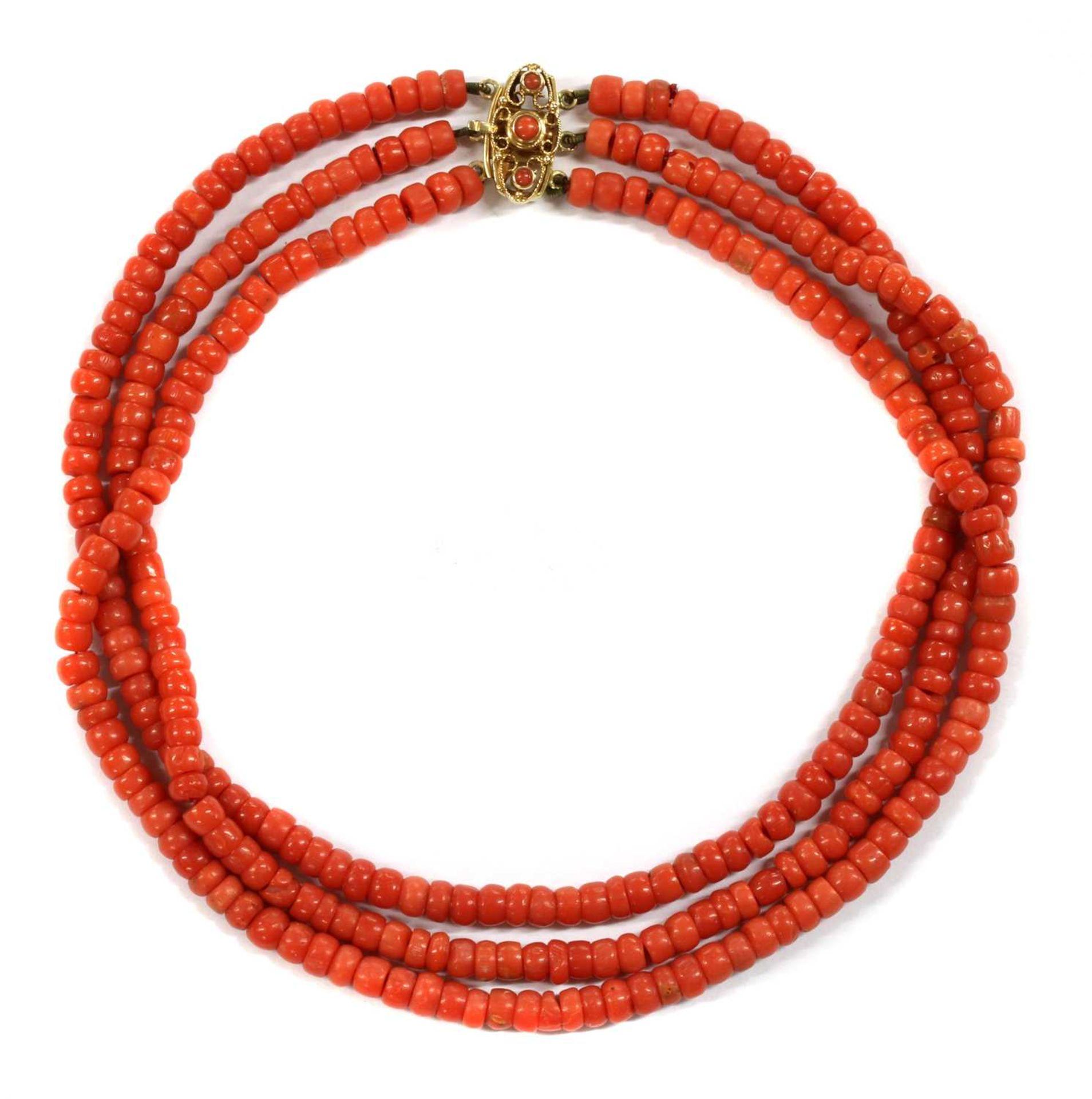 A Dutch three row uniform coral bead choker necklace,