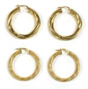 Two pairs of 9ct gold hollow hoop earrings,