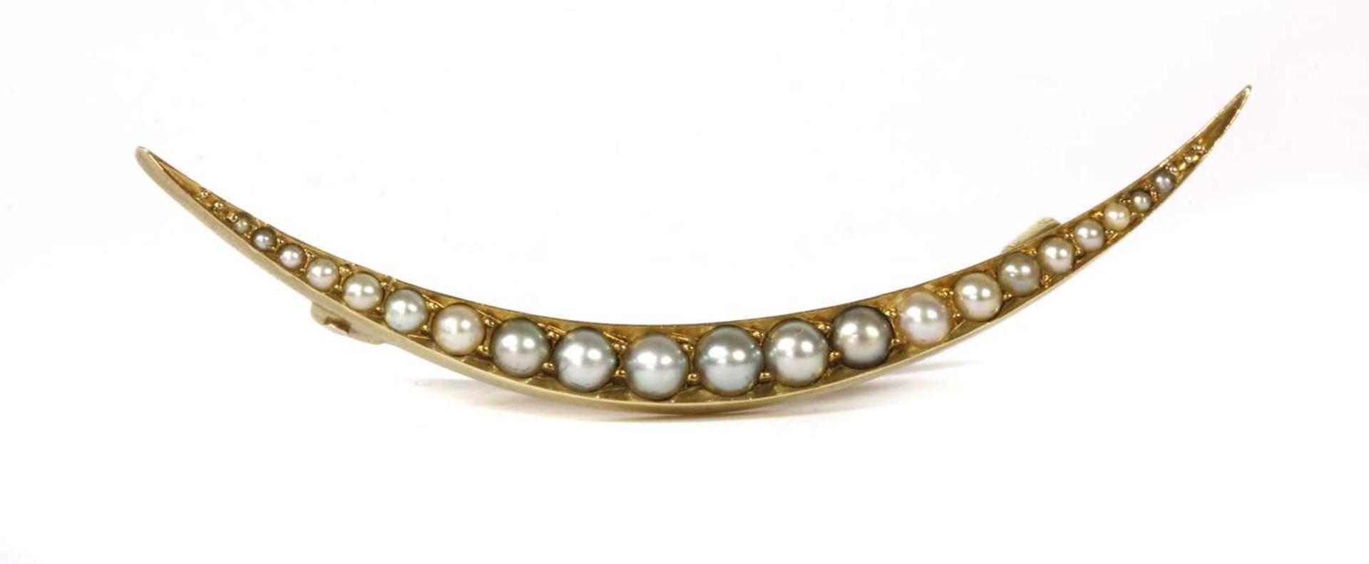 An Edwardian gold split pearl open crescent brooch,
