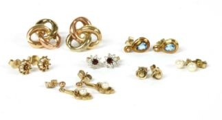 Seven pairs of gold earrings,