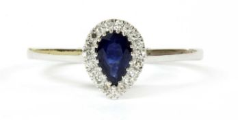 A white gold sapphire and diamond cluster ring,