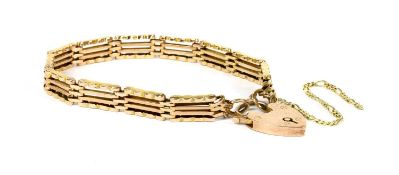 A gold four row gate bracelet,