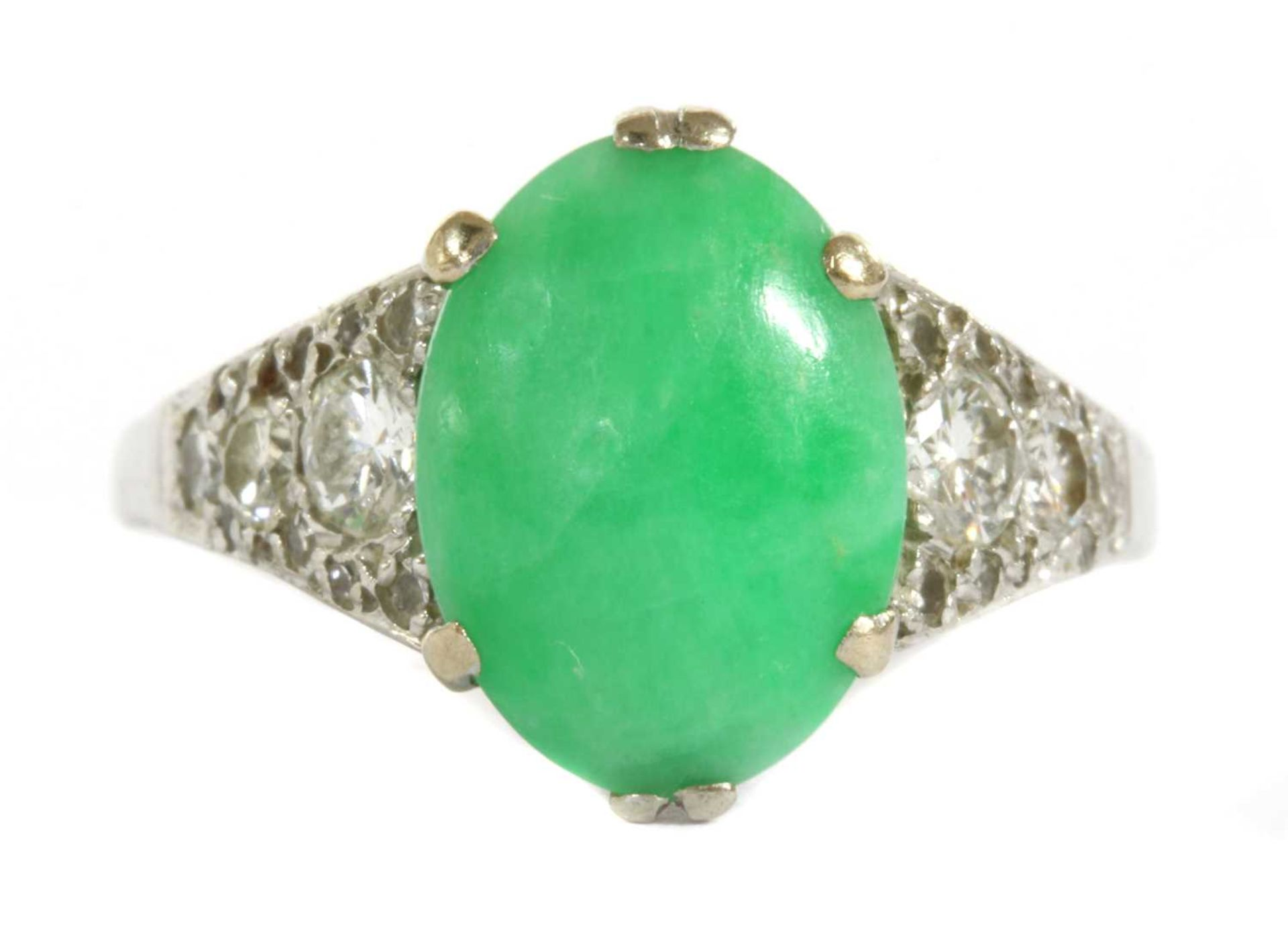 A white gold jade and diamond ring,