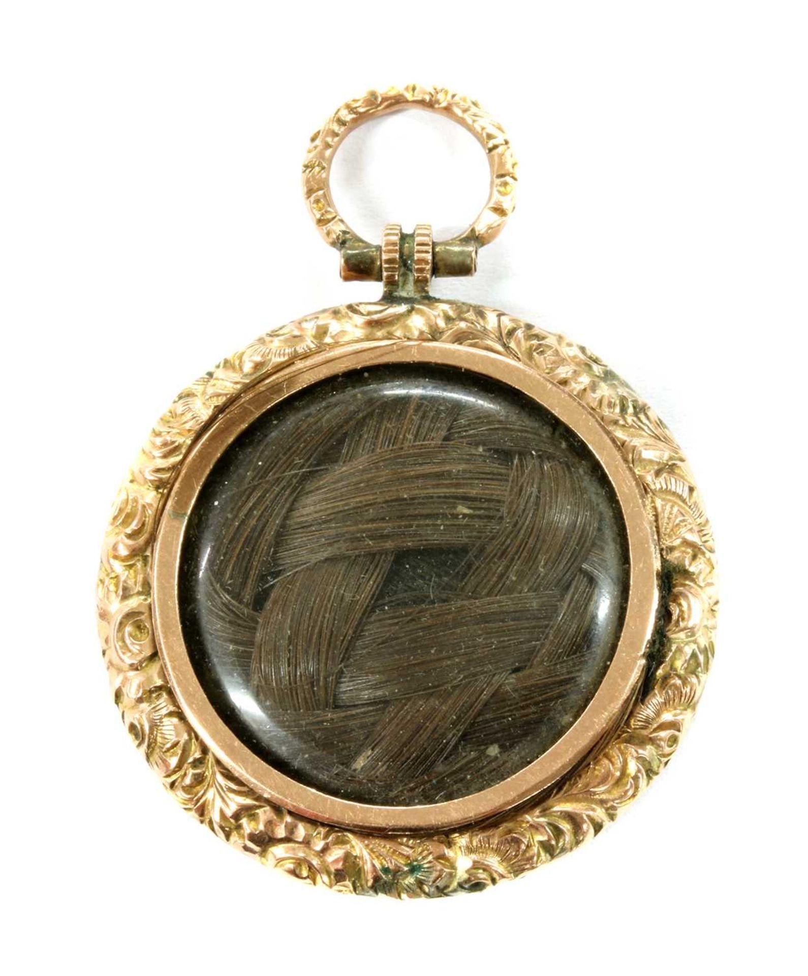 A Victorian gold mounted shakudo memorial locket, - Image 2 of 2