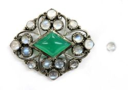 An Arts & Crafts silver dyed green agate and moonstone brooch,