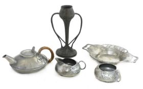 A collection of Tudric pewter items,