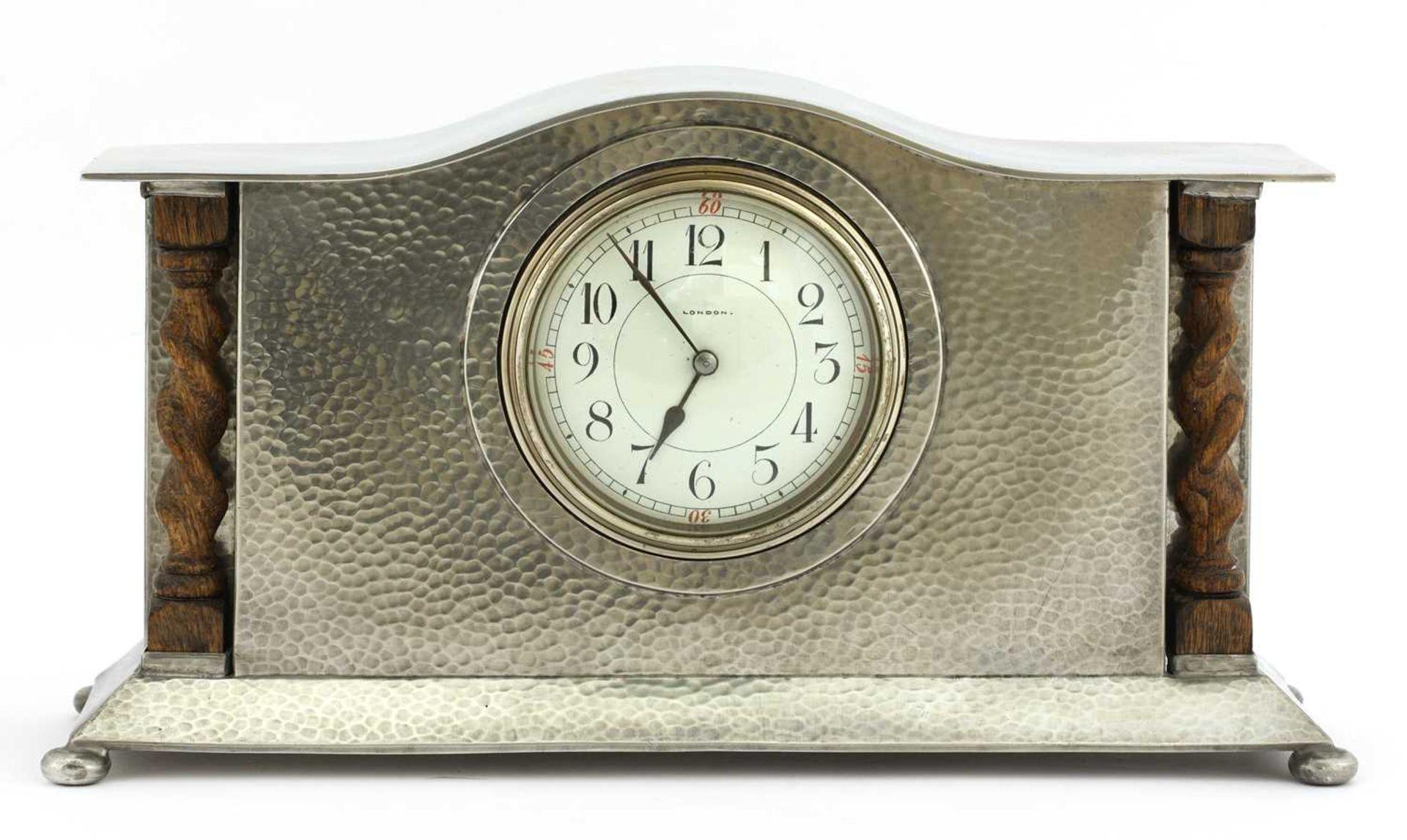 A Liberty Tudric pewter mantel clock,