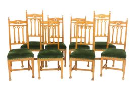 A set of eight Arts and Crafts oak dining chairs,