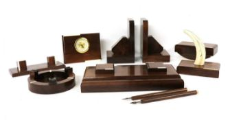 A French Art Deco rosewood and ivory mounted desk set,