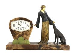 An Art Deco bronze and marble mounted mantel clock,