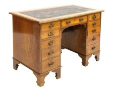 An Arts and Crafts walnut desk,