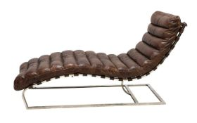 A tan leather and chrome lounger,