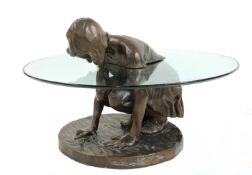 A contemporary bronze and glass 'She'll Find' coffee table,
