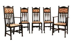 Five Arts and Crafts oak dining chairs,