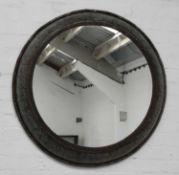 An industrial metal circular mirror,