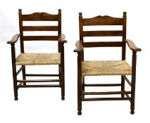A pair of rare Gordon Russell yew wood ladderback chairs,