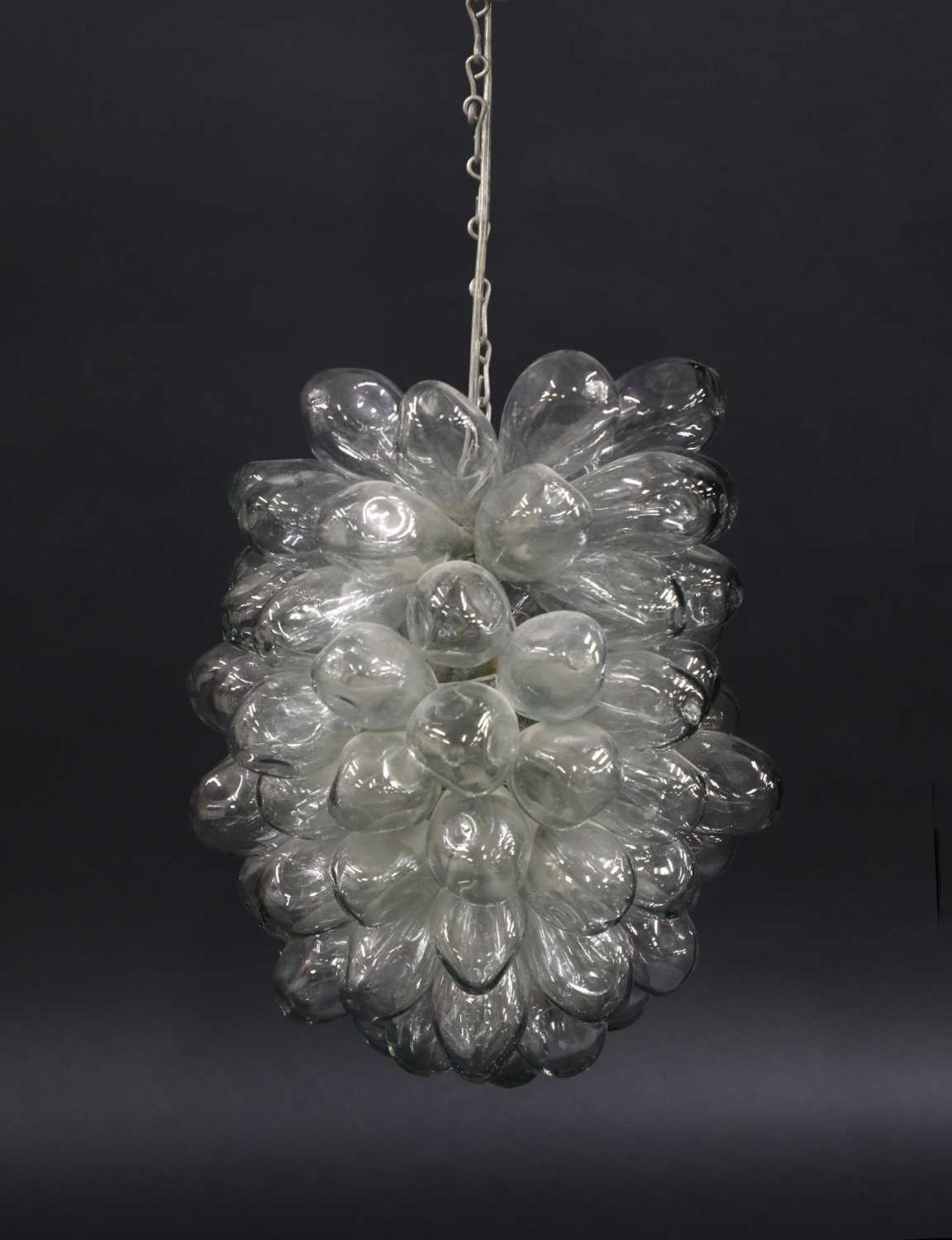 A multi-bubble blown glass pendant light,