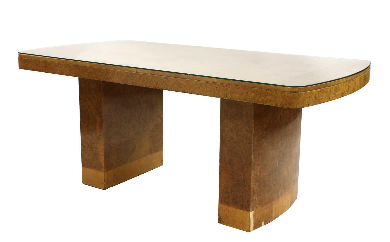 An Art Deco burr maple dining table,