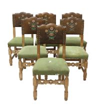 A set of six limed oak dining chairs,