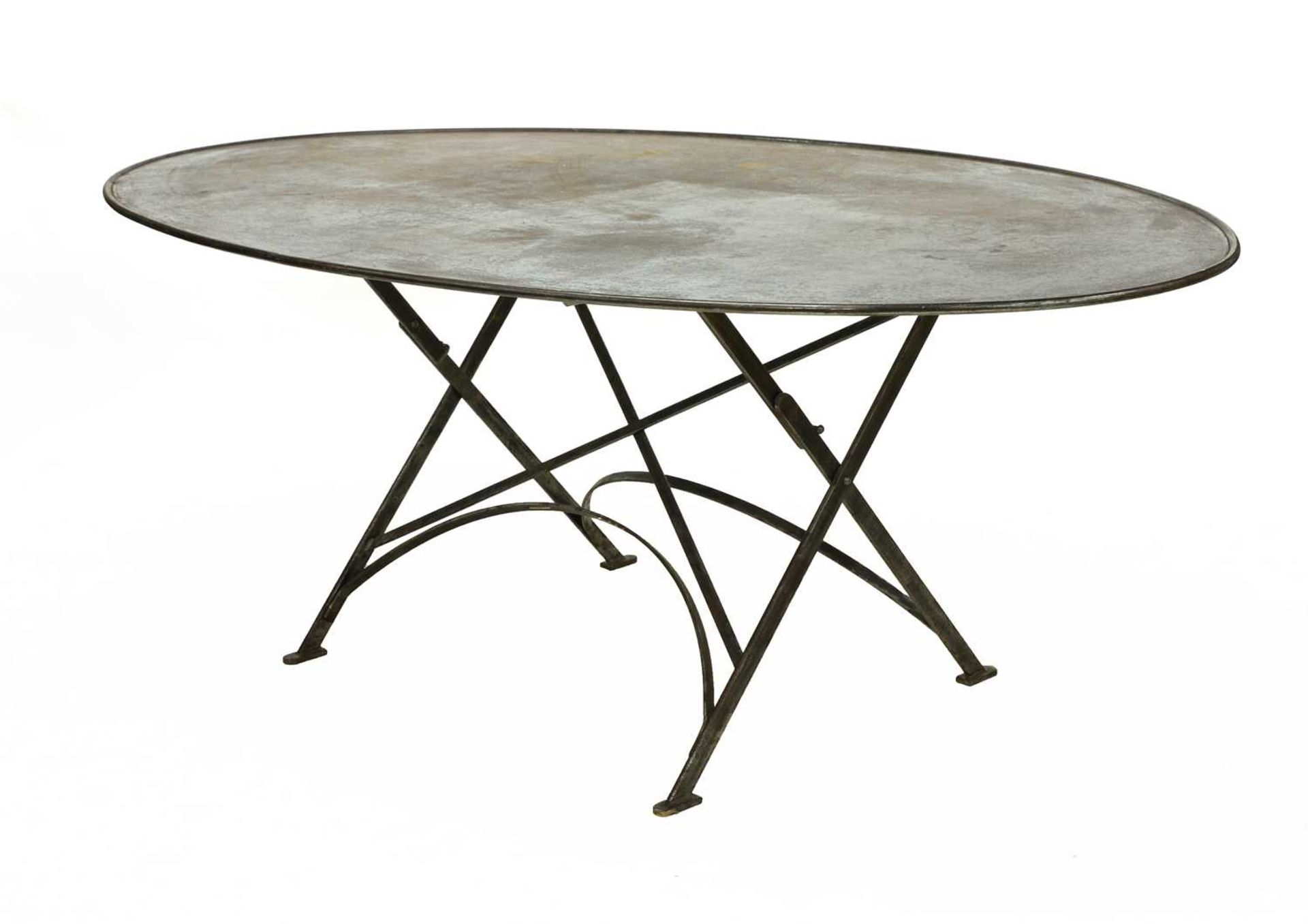 An oval steel folding dining table,