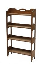 An Arts and Crafts oak free-standing set of shelves,