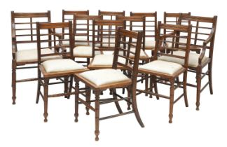 A set of twelve Arts and Crafts walnut chairs,