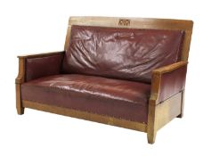 An Arts & Crafts oak settee,