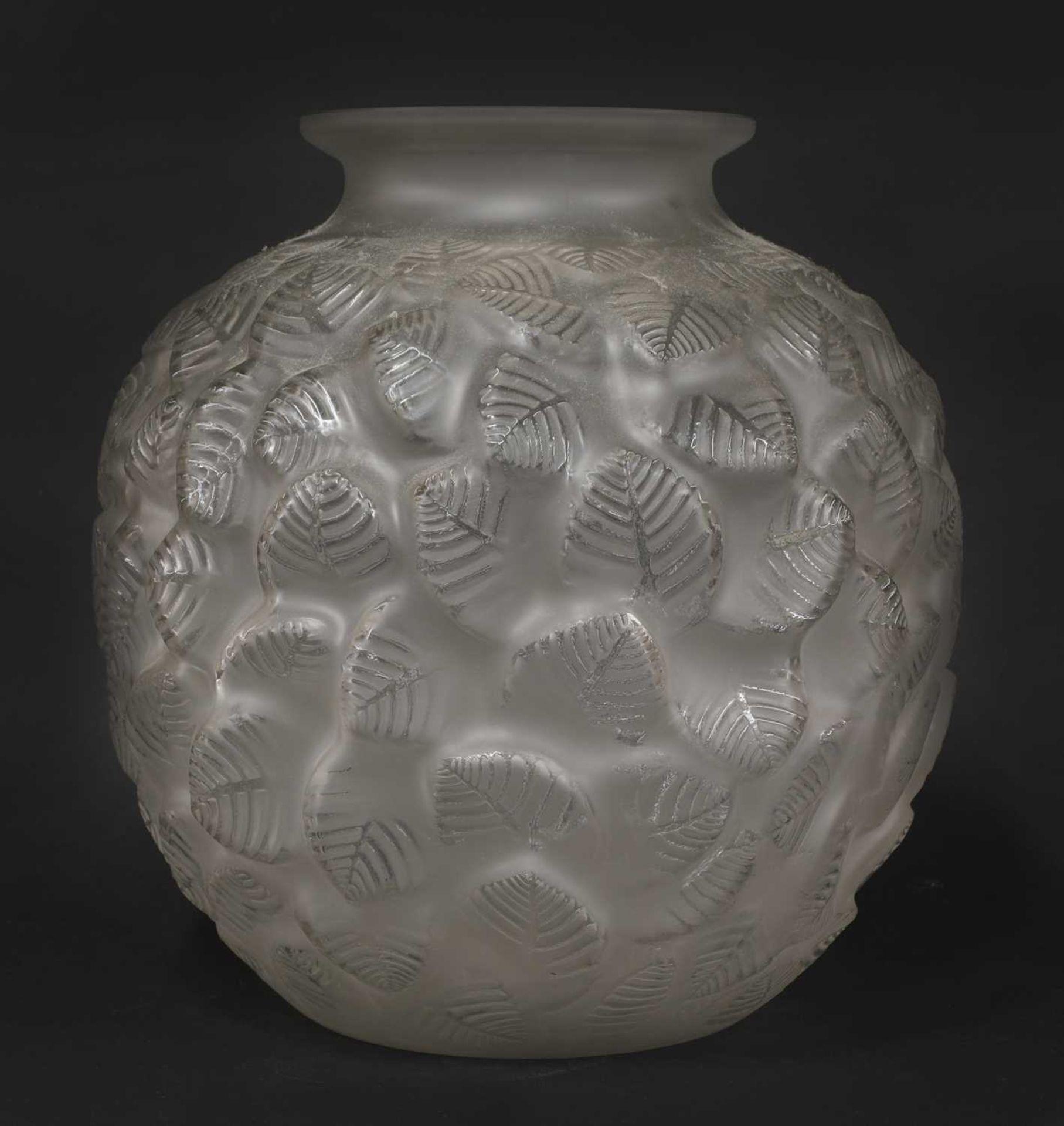 An Art Deco leaf moulded glass vase,