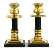 A pair of bronze and Bakelite candlesticks,