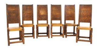 Six Robert 'Mouseman' Thompson oak dining chairs,