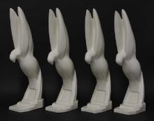 Four Art Deco moulded white glazed doves,