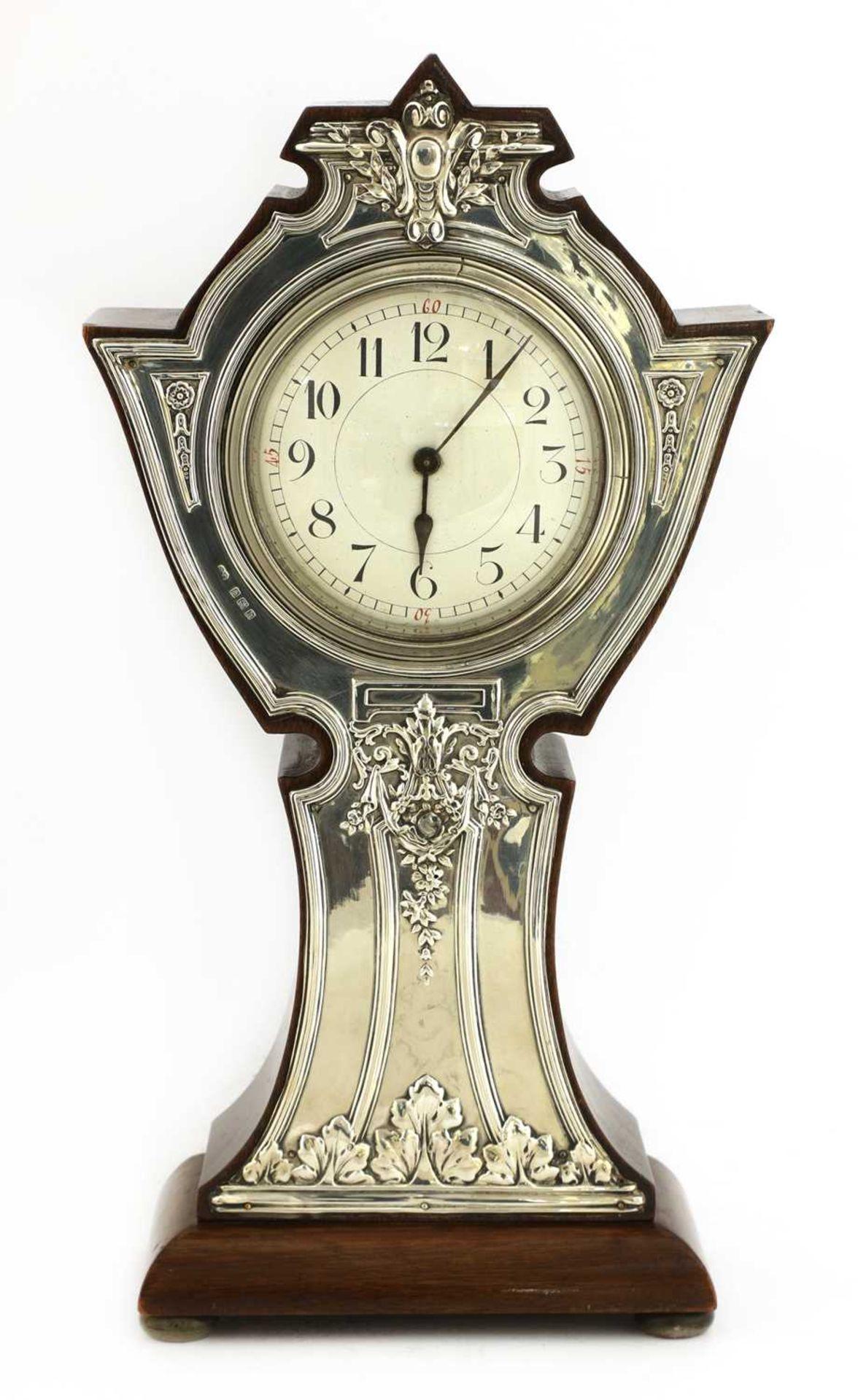 An Art Nouveau silver-mounted mantel clock,