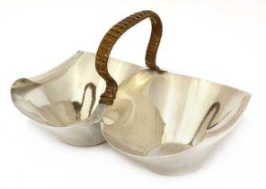 A silver double basket or bonbon dish,