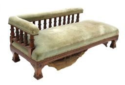 A Victorian Gothic oak and ebonised daybed,