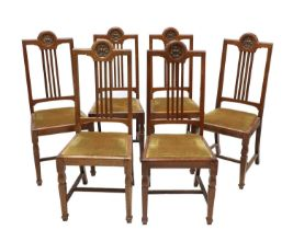 A set of six oak dining chairs,
