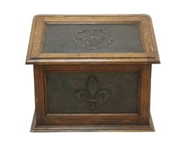 An Arts and Crafts oak and copper-mounted log bin,
