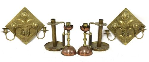 A pair of Aesthetic engraved brass wall lights,