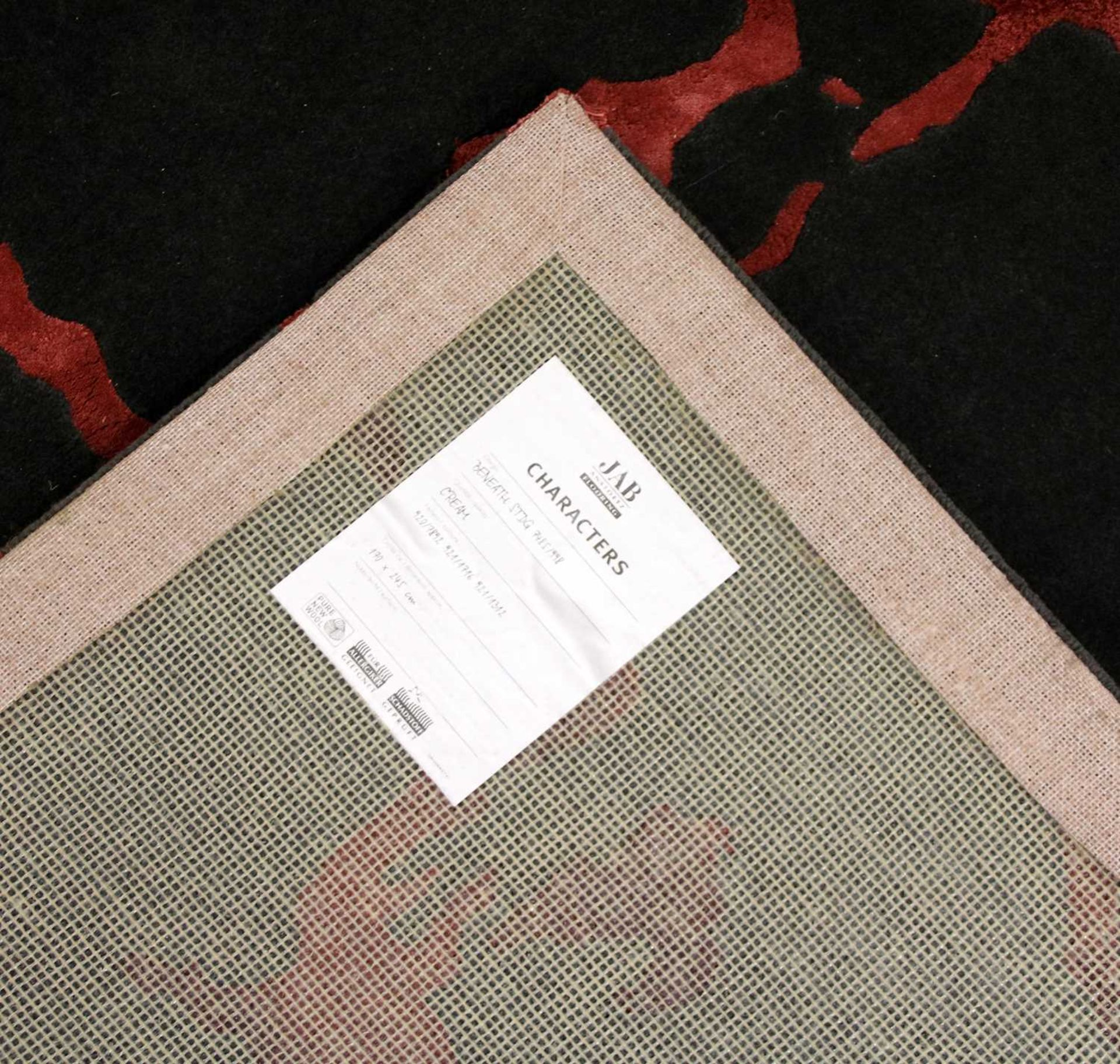 A contemporary grey and pink rug, - Image 2 of 2