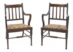 A pair of walnut armchairs,