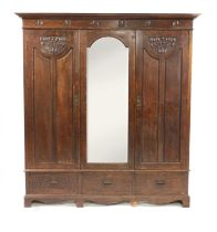 An Arts and Crafts oak wardrobe,