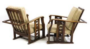 A pair of Art Deco oak reclining armchairs,