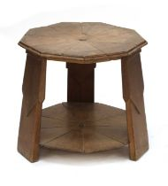 An unusual Arts and Crafts Baltic pine occasional table,