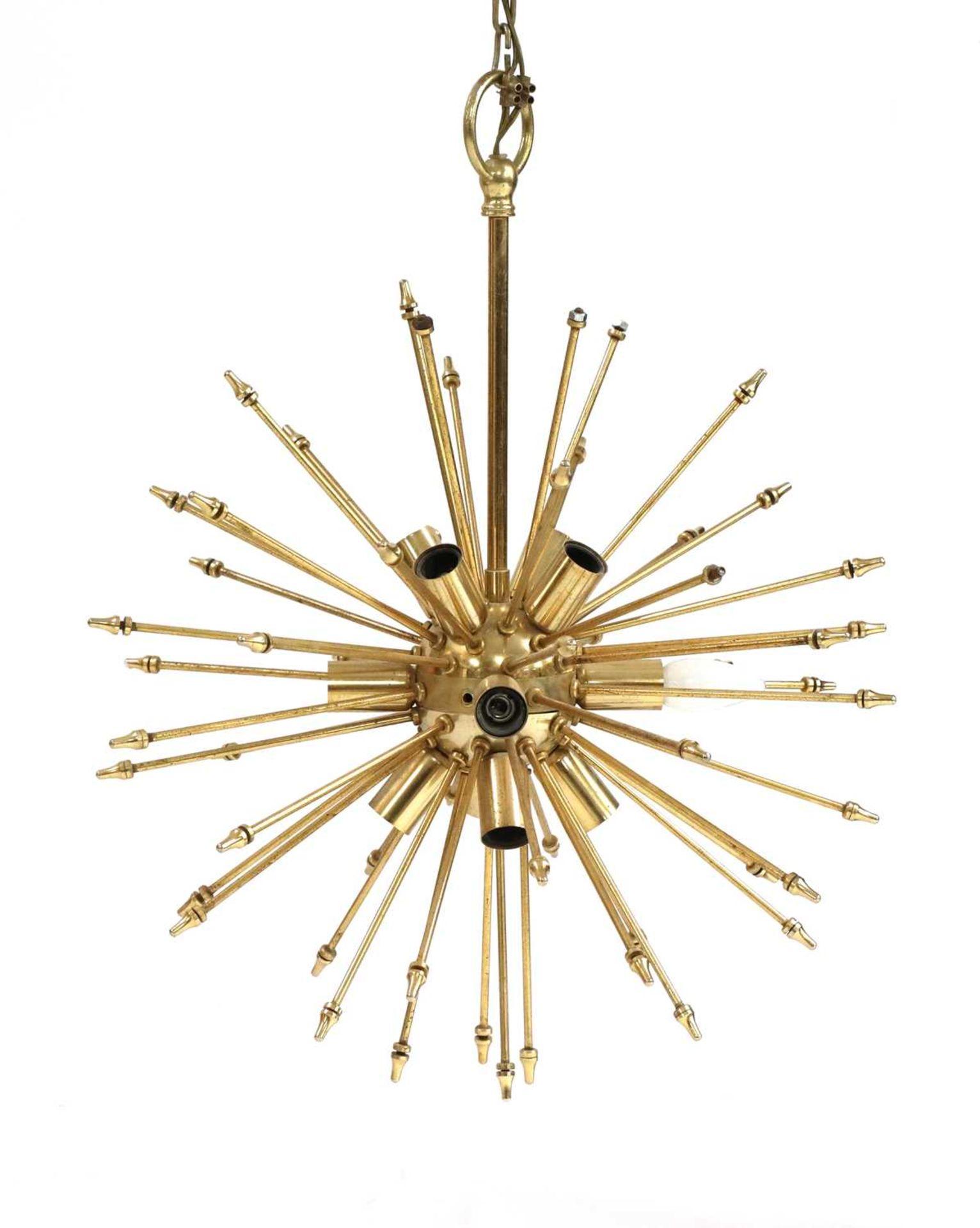 An Italian brass globe ceiling light,