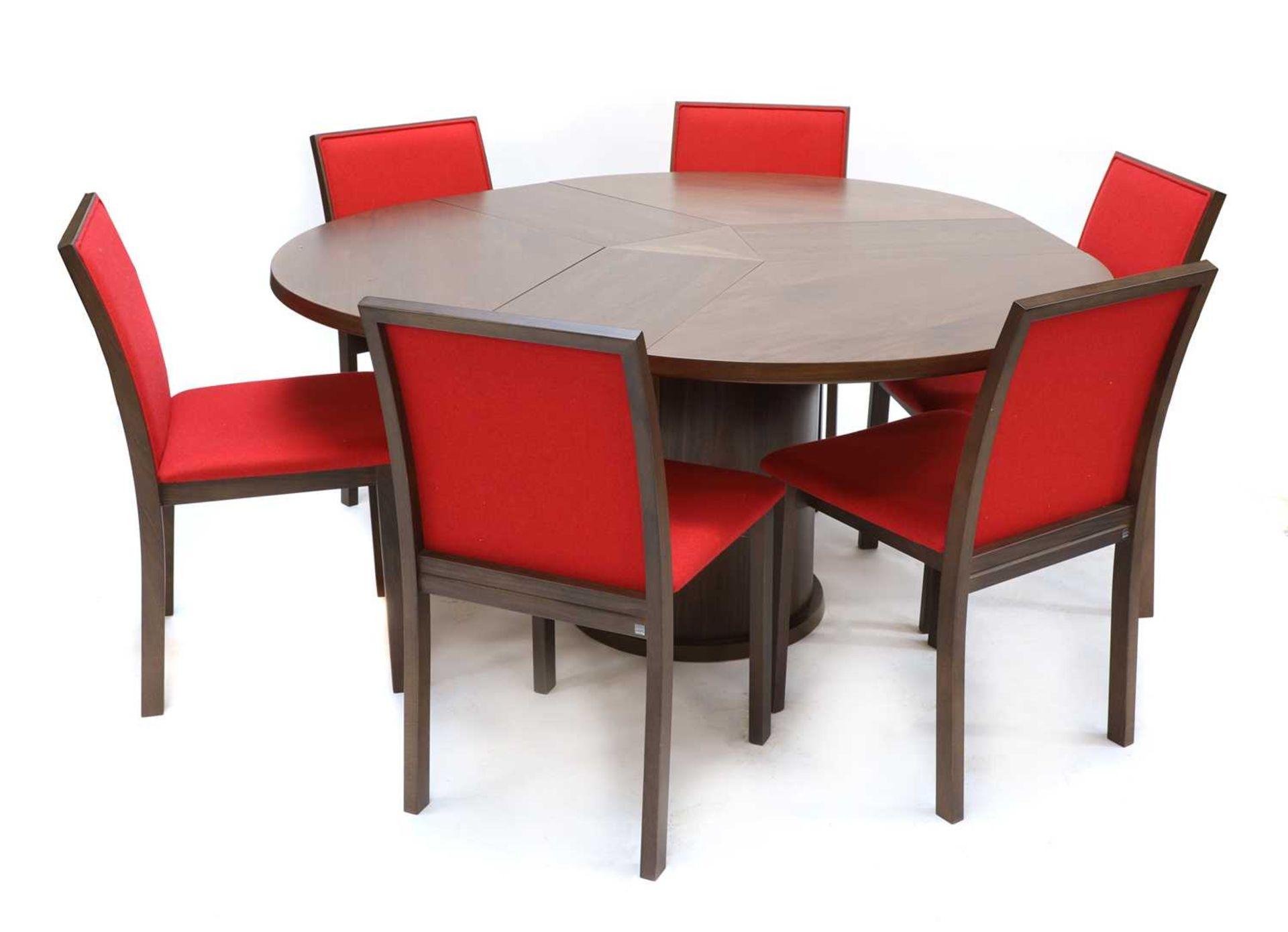 A Skovby 'Confide' walnut veneered extending circular dining table