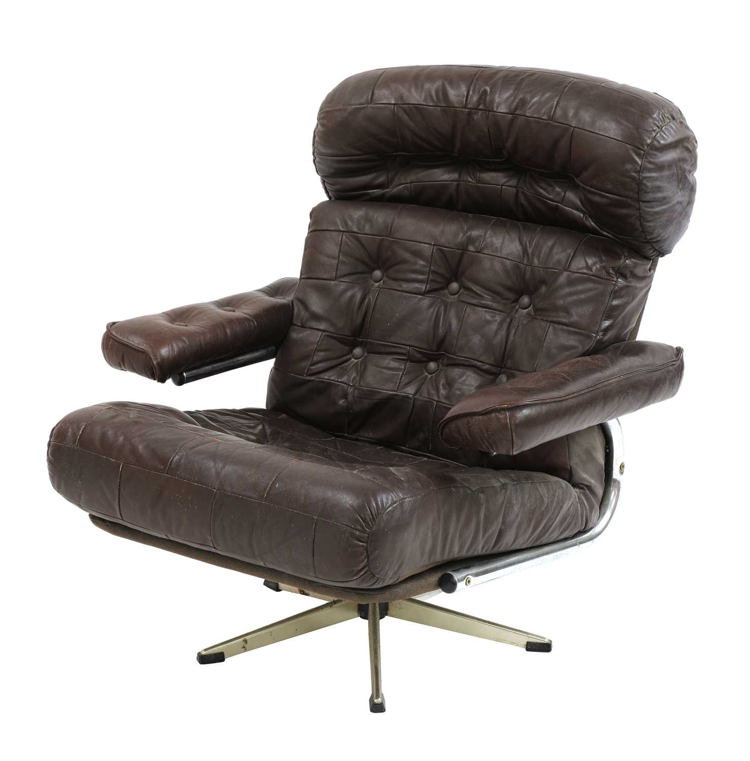 A chocolate leather lounger,