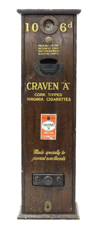 A 'Craven A' cigarette dispenser,