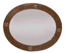 A Liberty oval copper wall mirror,